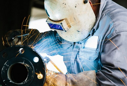An auto darkening welding helmet protects the welder's vision