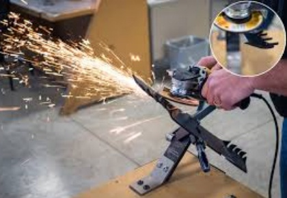This worker is sharpening the blade using angle grinder